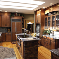 A contemporary kitchen setup with wooden cabinets.