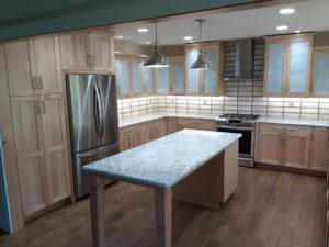 Wellborn Bristol brown kitchen cabinet and marble table.