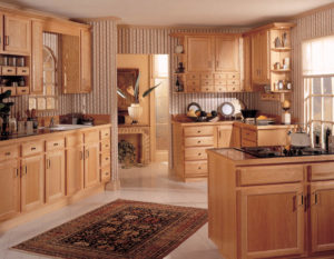 Wellborn Essex Oak brown kitchen cabinets.