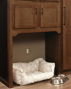 Wellborn Franklin 2 pet cushion and food tray under a cabinet.