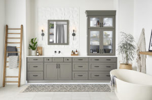 White bathroom with dark gray cabinets.