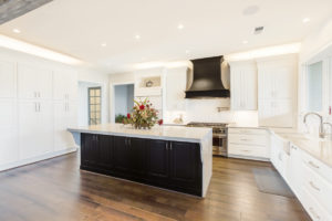 Wide view of white cabinets in kitchen area.
